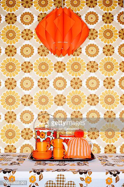 tea tray on table with patterned table cloth under red light shade - kitsch - fotografias e filmes do acervo