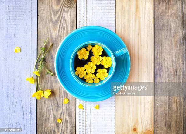 tea with buttercups - buttercup stock pictures, royalty-free photos & images