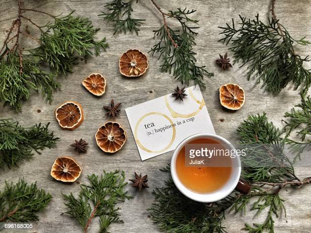 Tea with fir tree branches and dried oranges