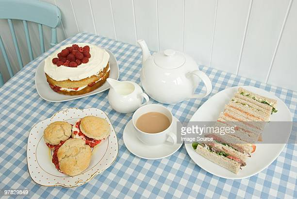 Tea with sandwiches and cakes