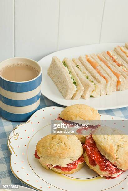 Tea with scones and sandwiches