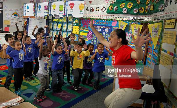 Teacher Adriana Rosas leads kindergarten students reciting nutrition chants at Aloha Health Medical Academy in Lakewood Friday April 4 2014