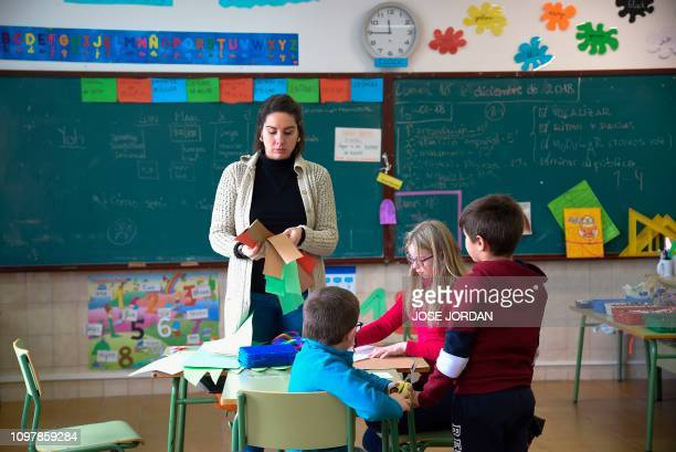 Teacher Ana Lomba gives a class to some kids at a school of Oliete northeastern Spain on December 17 2018 Residents began moving away from rural...