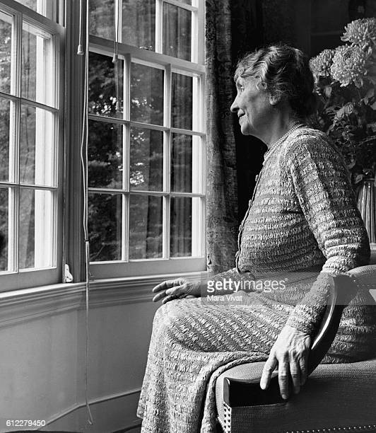 Teacher and author Helen Keller rests beside a window in a sitting room Keller achieved wide recognition by overcoming blindness and deafness to...