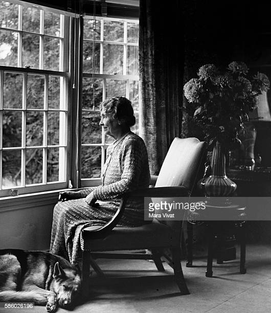 Teacher and author Helen Keller rests beside a window with her German shepherd sleeping at her feet Keller achieved wide recognition by overcoming...