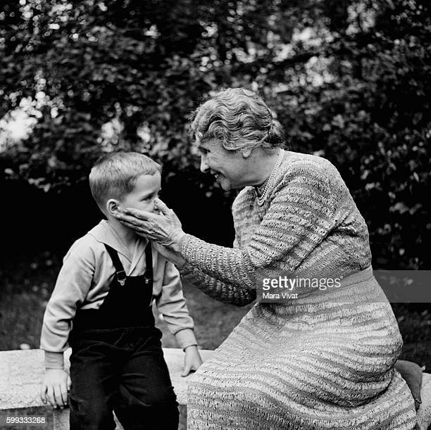 Teacher and author Helen Keller touches the face of a young boy Keller achieved wide recognition by overcoming blindness and deafness to become a...