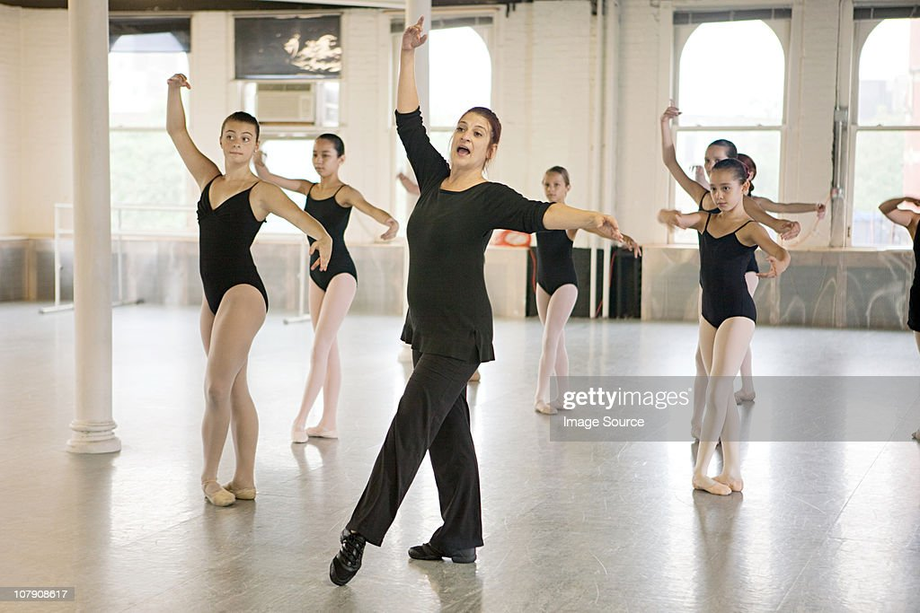 Teacher and ballet dancers : Stock Photo