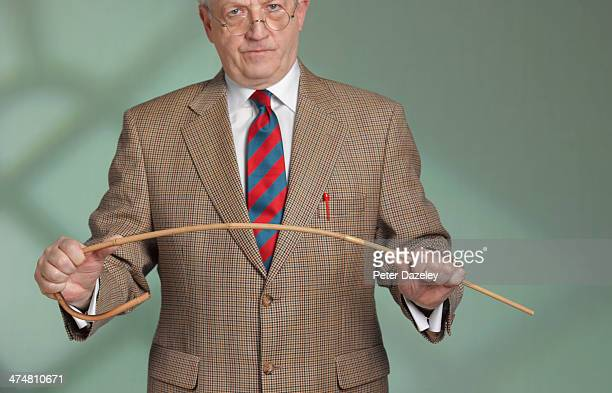 teacher and cane - corporal punishment stock pictures, royalty-free photos & images