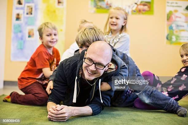 teacher and children enjoying in kindergarten - preschool student stock pictures, royalty-free photos & images