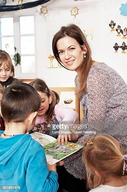 Teacher And Children In Nursery School, Kottgeisering, Bavaria, Germany, Europe