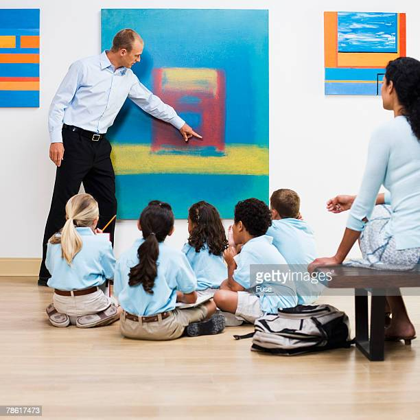Teacher and Elementary Students in Art Gallery