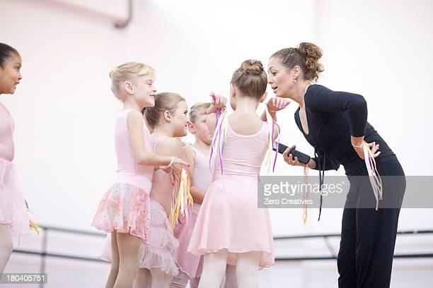 Teacher and enthusiastic young ballerinas