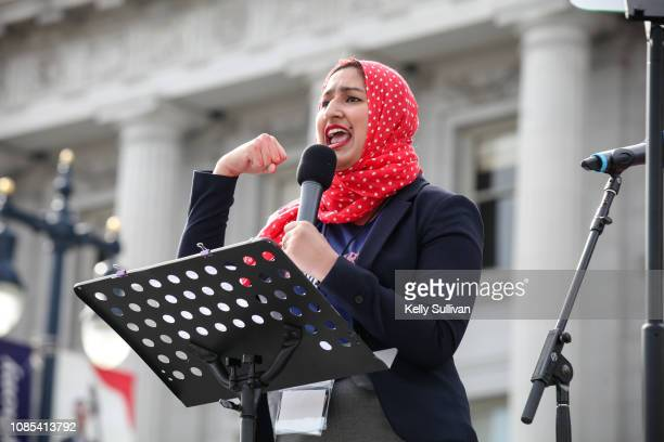 Teacher and FranklinMcKinley Board of Education member Maimona Afzal Berta speaks onstage at the Women's March San Francisco in Civic Center Plaza on...