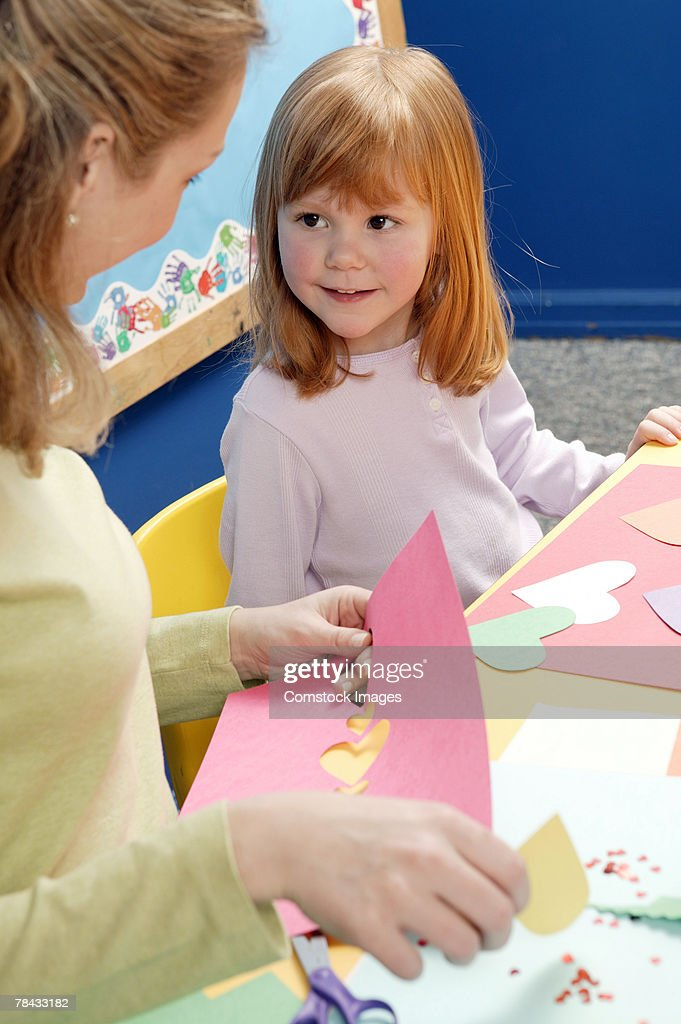Teacher and girl doing arts and crafts : Stockfoto