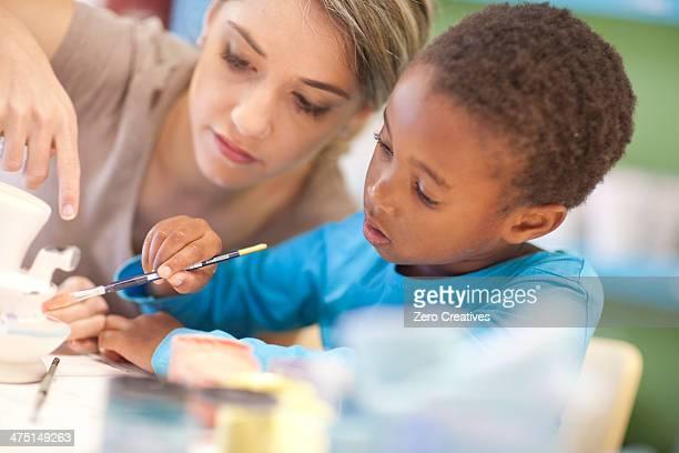 Teacher and girl in art class