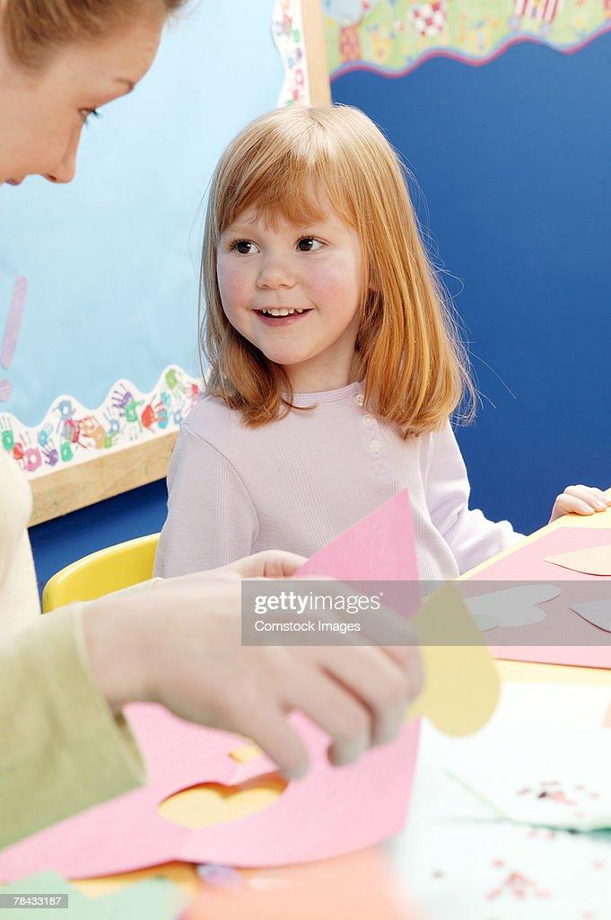 Teacher and girl : Stockfoto