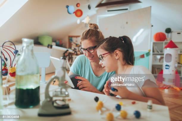 Teacher and girl using digital tablet