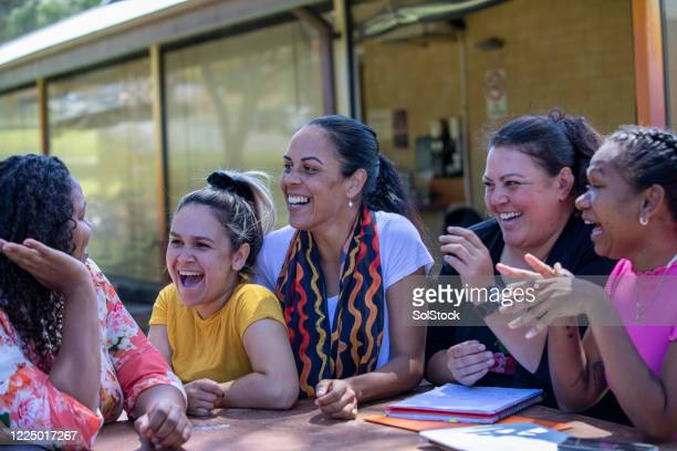 teacher and her female students - perth australia stock pictures, royalty-free photos & images