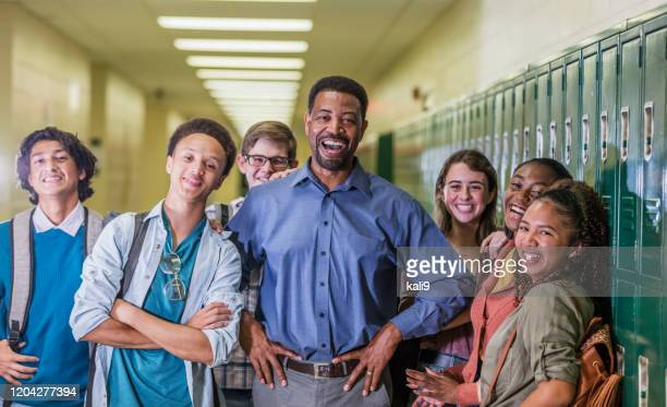 teacher and high school students hanging out in hallway - school principal stock pictures, royalty-free photos & images