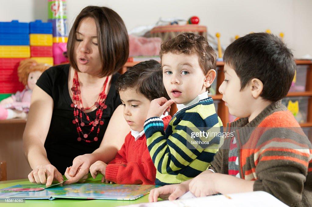 Teacher and Preschooler : Stock Photo
