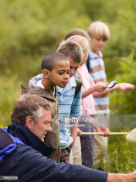 teacher and pupils at nature reserve - nature reserve stockfoto's en -beelden