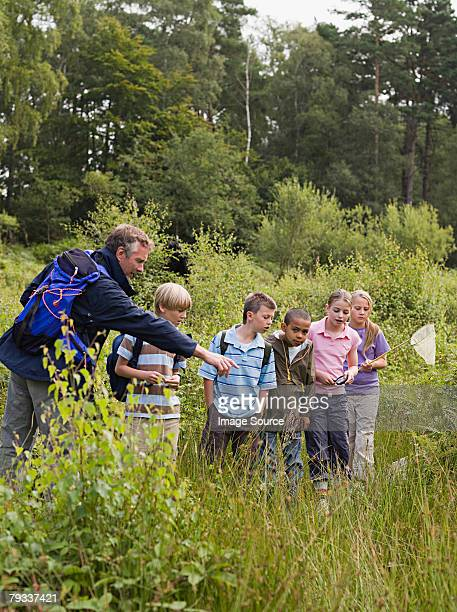 teacher and pupils at nature reserve - field trip stock pictures, royalty-free photos & images