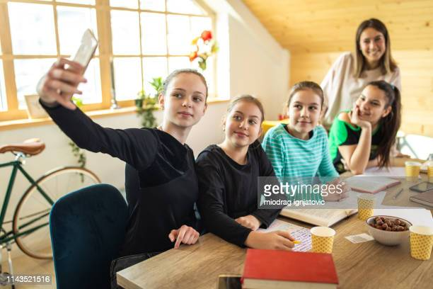 teacher and pupils making selfie at school - human age stock photos and pictures