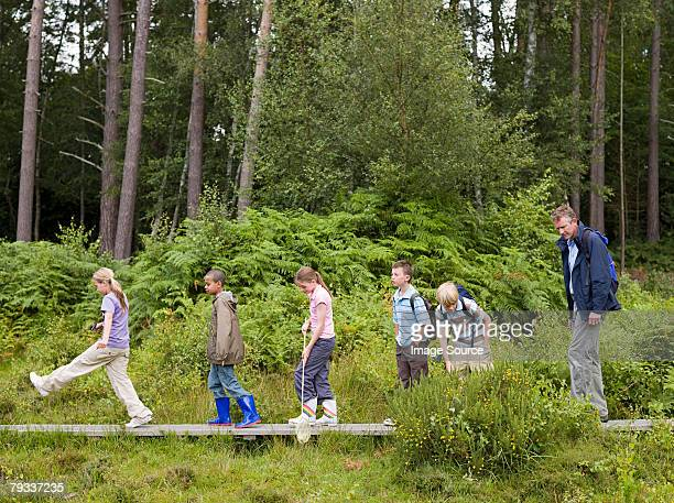 Teacher and pupils on field trip