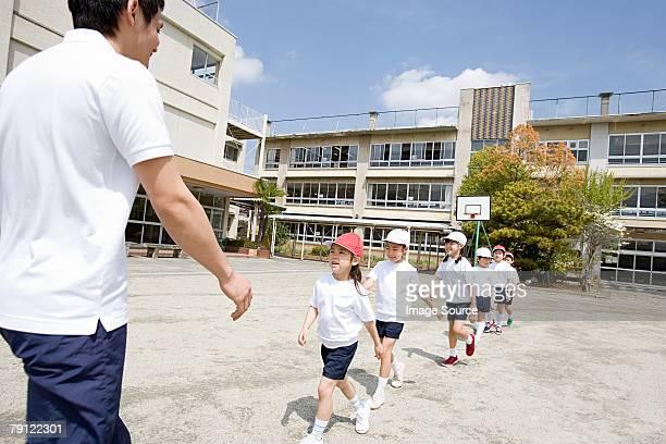 A teacher and school children