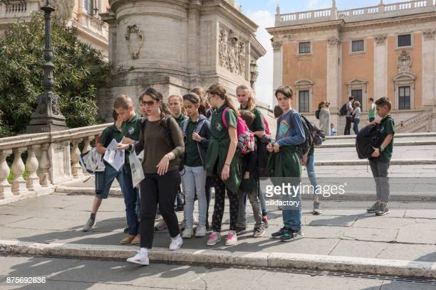 Teacher and school class on excursion at the Capitoline Museums