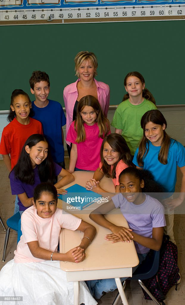 Teacher and Students in a Classroom : Stock Photo