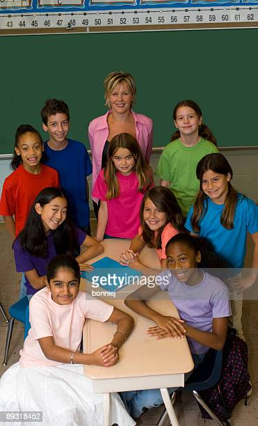 teacher and students in a classroom - class photo stock photos and pictures