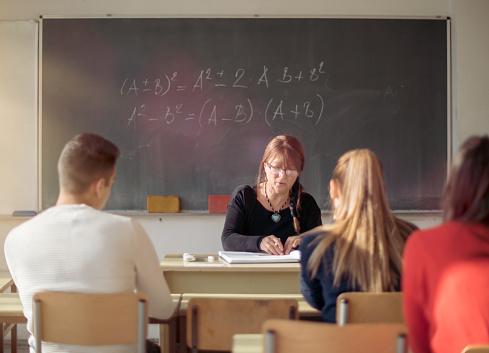 Teacher and students in high school Classroom - gettyimageskorea