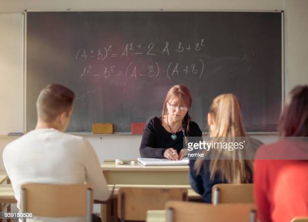 Teacher and students in high school Classroom