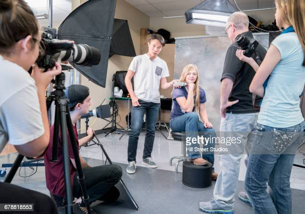 teacher and students in photography class - photo shoot stock pictures, royalty-free photos & images