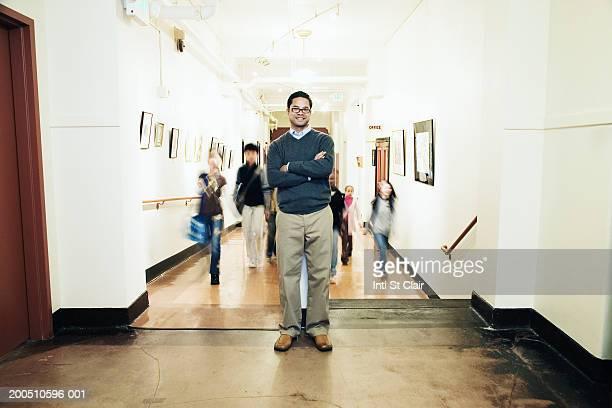 teacher and students (9-13) in school corridor (focus on teacher) - 校長 ストックフォトと画像