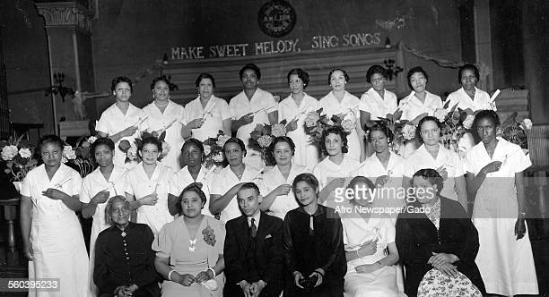 Teacher and students of the Madame CJ Walker beauty school at a school, Washington DC, June 5, 1937.