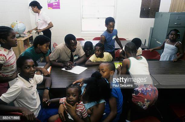 A teacher and students participate in educational classes at Chicago Commons a West Side center based in the Henry Horner Homes Chicago Illinois late...
