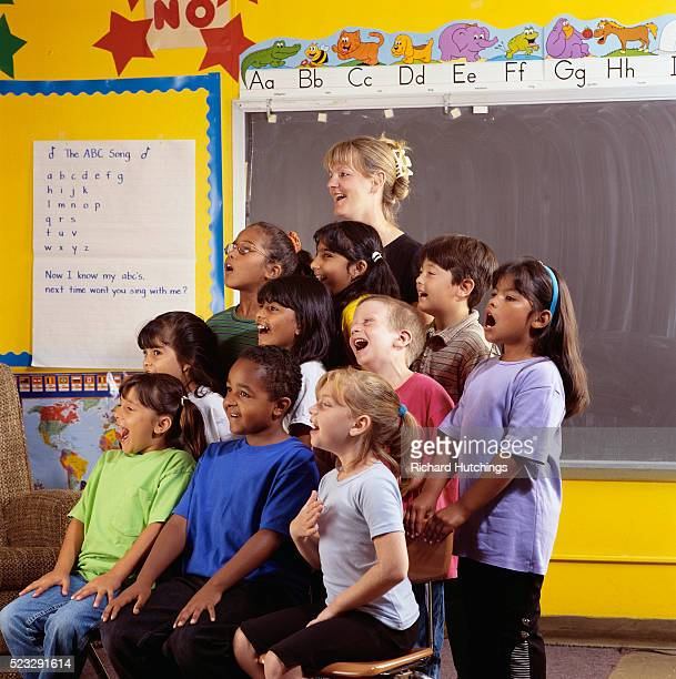 Teacher and Students Singing in Class