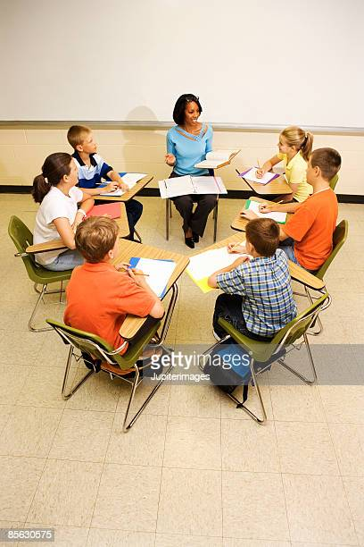Teacher and students sitting in classroom