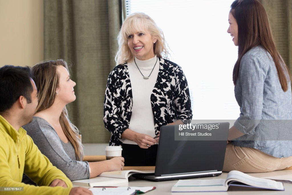 Teacher and students talking in meeting : Foto stock