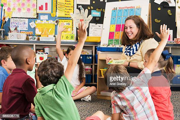 teacher and students using flash cards in classroom - elementary age stock pictures, royalty-free photos & images