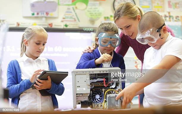 Teacher and students working in classroom