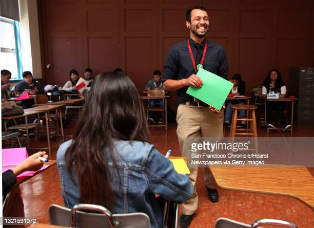 Teacher Andre Higginbotham working with seniors studying American democracy at Washington High School in San Francisco, Calif. The San Francisco...
