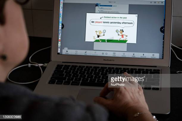 A teacher assigns homework to her students online during the coronavirus outbreak in Italy To fight the spread of the coronavirus throughout the...