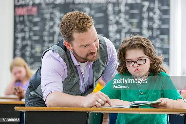 Teacher Assisting a Student