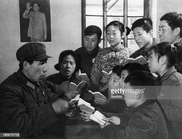 A teacher at a school for deaf mutes reads to students from 'Quotations From Chairman Mao' People's Republic of China 1969