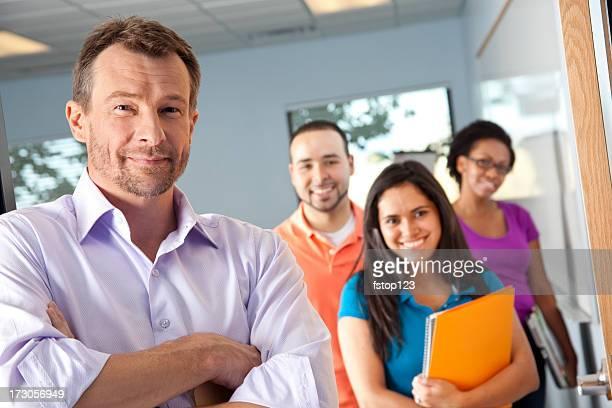 Teacher at door, college students in classroom. Professor.
