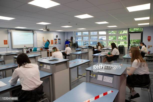 Teacher at the front of the class teaching a group of Year 10 pupils. Ortu Gable Hall School in Corringham, Essex return after a long break due to...