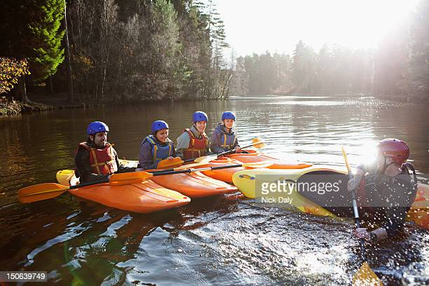 teacher capsizing kayak in still lake - guidance stock pictures, royalty-free photos & images